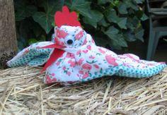 Henne aus Gartenhandschuh