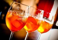 How the Aperol Spritz became Italy's favorite cocktail, video how-to, aperol 3-2-1 campaign, and variations by region. Ice: Use large cubes, never crushed ice, essential for the drink's slow dilution. Prosecco: Use a chilled, dry Prosecco to impart acidity and effervescence, which whet the appetite and cleanse the palate while snacking with your Spritz. The Glass: Spritzes are served in standard wine glasses or rocks glasses and almost always with a black straw.