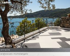 Designed by architect Roberto Spotti of Actual Spotti, this stunning terrace overlooking the sea is made from Lapitec® Lithos in Nero Antracite and Arabescato Michelangelo brings a touch of modern flair to this Italian home.