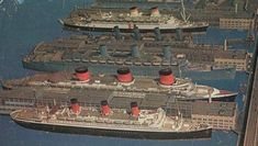 """Conte Di Savoia, Aquitania, Queen Mary, Normandie and Ile-De-France line the piers of """"Luxury Liner Row"""" in New York City, late 1939"""