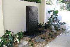 Modern, geometric water feature for the front yard. Discovered on www.Porch.com