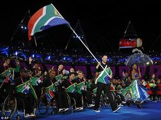 South Africa's runner Oscar Pistorius leads his team during the Opening Ceremony