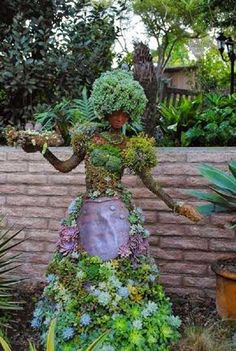 Use recycled materials to enhance wire topiaries. Succulents are lower care than vines. Wire-wrap and plant short or tall pedestals as bases for pots or busts.