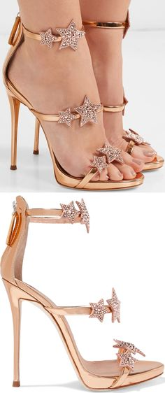 The slim straps on these rose gold 'Coline' sandals are decorated with crystal-embellished suede star appliqués. Although the heel is high, this pair is balanced out with a platform for support.
