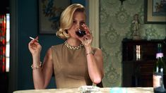 Whenever she drank and smoked at the same time. | 13 Moments When Betty Draper Didn't Give A F%$k