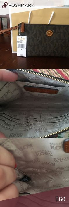 MK clutch and a MK travel makeup bag SOLD MK brand new clutch, brown with gold, travel bag is black with silver both of them brand new never use. Michael Kors Bags Clutches & Wristlets