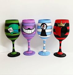 Wonderland set of 4 inspired, hand painted wine glasses. by AWhimsicalHoot on Etsy