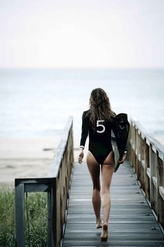 STOP EVERYTHING AND WATCH GISELE IN THE NEW CHANEL NO. 5 VIDEO -- Yes, that would be a Chanel surfboard and wetsuit.