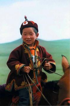 Asia: Mongol boy on horseback