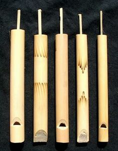 MUSICAL INSTRUMENTS: Bamboo Swanny Whistle - 1.5cm x 1.5cm x 13cm. Made from young bamboo and decorated with an etched design. The bamboo slider allows the player to change the pitch of the whistle in a trombone-like way. Also used for recreating bird calls.