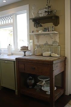 love open shelving in kitchens, and and old unexpected piece like this one...