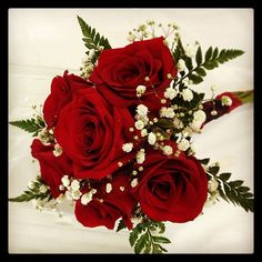 Red rose bouquet with baby's breath & greenery. I want a bouquet of red roses, the first flowers my fiance ever gave me