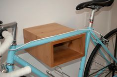 Wooden wall mount bike rack for bicycle. $135.00, via Etsy.