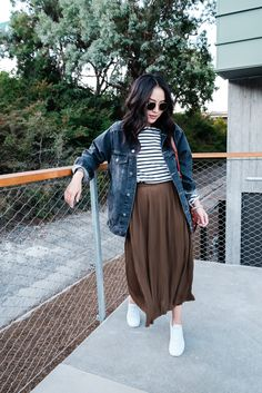 striped tee, green maxi skirt, white sneakers, denim jacket