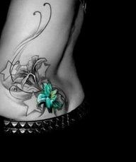 SEE MORE ADORABLE BLACK AND BLUE FLOWERS WITH STAR TATTOO ON SIDE BODY