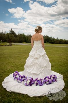 Purple weddings are in this year which works for me because it's my favourite colour. I love how this beautiful bride looks with her flowers and that stunning sky.