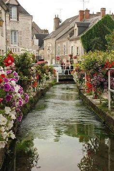 Beaugency, Loire Valley, France- The River Ru runs right down the middle of the street called Rue de Ru / Photography by Paul & Kelly
