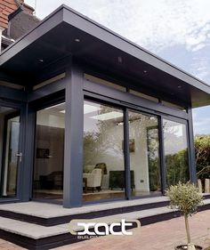 An installation of totally bespoke grey aluminium fascia, soffit and cladding supplied and installed to a single storey rear extension in Brook, Surrey. The grey aluminium provides a perfect finish for the sliding doors and other glazing elements. House Extension Design, Roof Extension, House Design, Garden Design, Aluminium Cladding, Aluminium Doors, Grey Exterior, Exterior Design, Roof Soffits