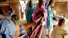 Maradi, NIGER: A woman is vaccinated against meningitis 17 March 2006 in Tchadoua near Maradi in South west Niger. Doctors without boarders (MSF), the Red Cross and the Health Ministery of Niger have embarked on a massive inoculation campaign targeting the population aged between 1 and 30 to combat the ressurgance of the disease. Last year Niger recorded 44 deaths due to cerebro-spinal meningistis and noted some 600 cases near Maradi. AFP PHOTO ISSOUF SANOGO (Photo credit should read ISSOUF…