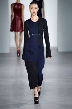 Long, sporty shapes, like midi-length skirts, round-necked coats and shells, mid-length coats, all skimmed the body. He color-blocked navy and black panels into dresses and coats, and a handful of perforated fit-and-flare minidresses.    - HarpersBAZAAR.com