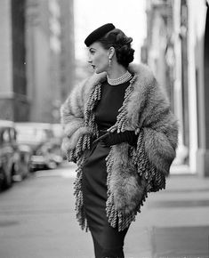 Leonie Vernet's fringed shawl of Norwegian Blue Fox is a Jacques Fath design from Hattie Carnegie, photo by Gordon Parks, October 1952