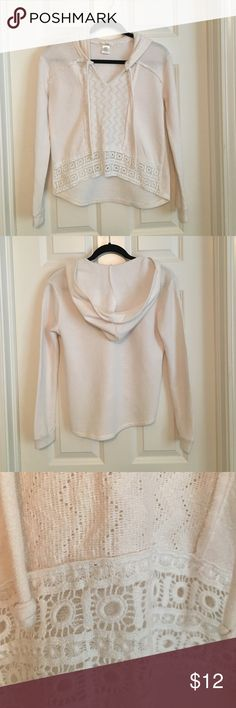 Top Casual, comfortable and classy all in the same top! Cream colored, hooded, V neckline with decorative lace inset down front of top and heavy brocade lace on the bottom of the front. The back has a longer hemline. love on a hanger Tops