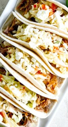 Pulled Pork Tacos with Sweet Chili Slaw Recipe ~ Says: This little taco is so full of flavor: tender, juicy pork, some fresh cilantro lime avocado cream, a sweet chili slaw with a little kick and a bunch of crumbled cheese. Flava bomb.