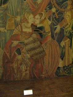 Detail from Tenture de Lérian et Lauréolle, Tapestry 3, Le Pardon du Roi, from South Pays-Bas, first quarter of the 16th century, wool and silk tapestry. Musee de Moyen Age (Cluny), Paris. I love her leopard sleeve turnbacks and the soft fabric in the pleated veil of her hood.