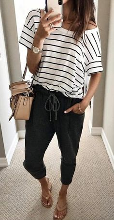 #summer #outfits women's white and black striped scoop-neck shirt and black jagger pants.
