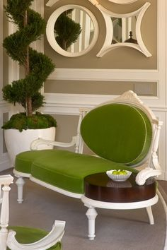 Green chair with table.