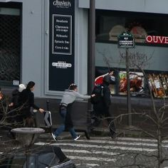 Suspects cornered with a hostage in Paris printing house  (Maclean's 09 January 2015)