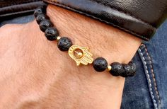 Check out this item in my Etsy shop https://www.etsy.com/uk/listing/231418189/golden-hamsa-hand-bracelet-mens-hamsa