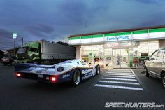 Street-registered & legal Porsche 962C race car makes a quick stop at the FamilyMart in Japan, the autopia where anything can drive!