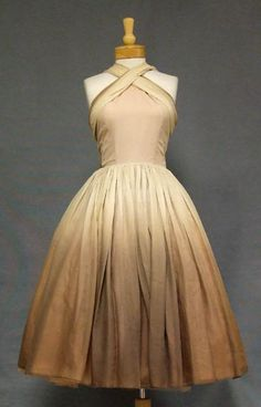 Lovely 1950's cocktail dress. I don't know what I love more -- the criss-cross halter or the tan-to-mocha ombre full skirt.