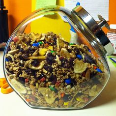 Home-made healthy trail mix with granola, dark chocolate m&ms, banana chips, dried cranberries, and whole raw almonds and cashews. :)