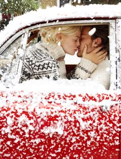 This is so precious. A kiss in a classic beetle covered in snow