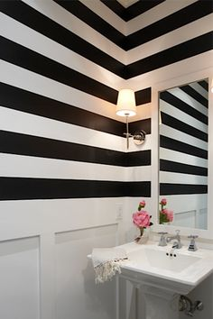A Preppy Home with a Flair for Fun// stripe wallpaper, powder room www.houseandleisure.co.za