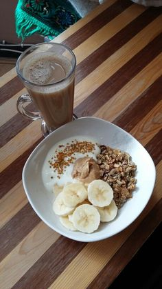 Perfect sweet breakfast ☕ Half a cup of @dorsetcereals honey granola, Greek yogurt topped with 1/2 tsp of bee pollen, tbsp of @meridianfoods cashew nut butter, 1/2 of a banana and coffee with @alpro unsweetened almond milk.  #fooddiary #fitfood #healthy #healthyeats #cleaneating #cleanfood #eatclean #food