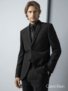 You'll look dashing in all black and a Jones New York Three-Button ...