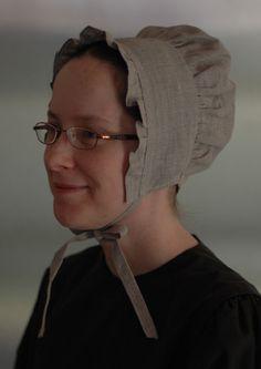 Quaker Jane wearing a natural linen cap from Rachel's Seamstress Services