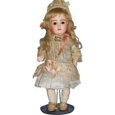 Rare 12 Kestner AT Bebe, immaculate pale bisque, brown sleep eyes with painted upper and lower lashes, her original blonde mohair wig and her original