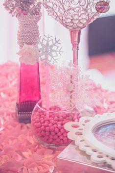 Pink centerpieces at a Winter Wonderland birthday party! See more party ideas at CatchMyParty.com!