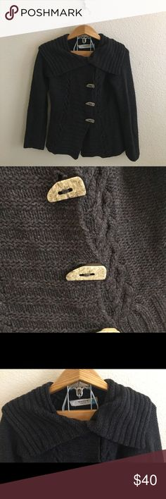 Anthropologie Sparrow Toggle Front Cardigan Size medium charcoal gray sweater by Sparrow from Anthropologie. Super soft and cozy. Fold over collar. Toggle closure on the front. Long sleeves. Gently used, no flaws or holes. I ship daily - excluding Sundays and holidays - and I store items in a smoke free, pet free environment. Open to offers; bundles discounted! Anthropologie Sweaters Cardigans