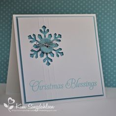 handcrafted Christmas card: Xmas Blessings by atsamom ... mostly white with light blue mat, button and ink ... negative space snowflake let the blue come through ... corderoy button with siver cord ... hand made embossed lines add an elegant touch ... luv this card!!