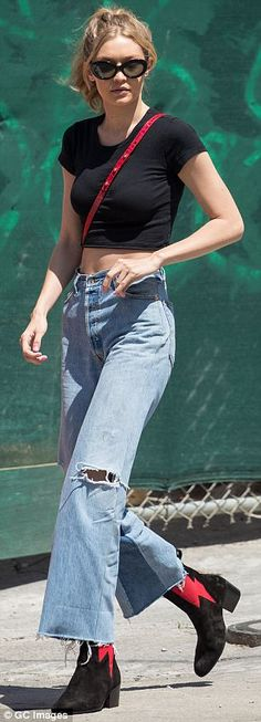 First Gigi Hadid, 22, accessorized her Re/Done jeans with a red Stalvey crossbody bag and black suede booties featuring red lightning bolts