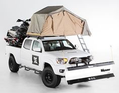 DC x Toyota Tacoma - This highly modified Tacoma features a snowplow, snowmobile deck, a rooftop tent, and scores of other snow-specific and luxury upgrades to make it the ultimate snowboard truck.