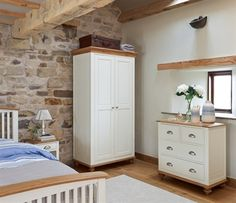 Salisbury - With oak tops and a white painted finish, the Salisbury range will brighten any bedroom. Classic in its styling, the range includes bedsteads, wardrobes, chests of drawers and bedside tables. Dining Furniture, Painted Furniture, Bedroom Classic, Bedside Tables, Salisbury, Chest Of Drawers, Wardrobes, Tall Cabinet Storage, Range