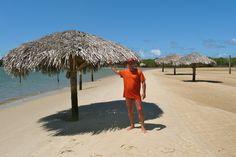 "Ernani looking for shade on ""Croa Dos Gores"" Island Brazil - Photo by Dan Trepanier"