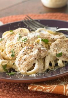 Fettuccine Alfredo with Chicken – Creamy sauce, succulent chicken, perfectly al dente pasta, a sprinkle of fresh herbs...all that's missing is the waiter and the check.