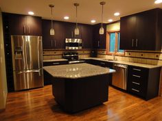 contemporary kitchen cabinets with black color and small island with granite countertop and pendant lamp best